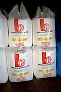 Ammonium nitrate fertiliser bags stored in a barn