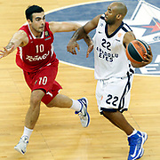 Anadolu Efes's Alfred Jamon Lucas (R) and Olympiacos's Konstantinos Sloukas (L) during their Turkish Airlines Euroleague Basketball playoffs Game 3 Anadolu Efes between Olympiacos at Abdi ipekci Arena in Istanbul, Turkey, Wednesday, April 17, 2013. Photo by Aykut AKICI/TURKPIX