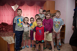 Bogdan, 4 1/2, (c) and fellow residents of the Lugansk Orphanage No.1 pose for a group photograph.