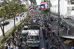 © Licensed to London News Pictures. 20/01/2014. A large crowd of Anti-Government protestors march in an attempt to shutdown the Government Savings Bank in Bangkok Thailand. Anti-government protesters launch 'Bangkok Shutdown', blocking major intersections in the heart of the capital, as part of their bid to oust the government of Prime Minister Yingluck Shinawatra ahead of elections scheduled to take place on February 2. Photo credit : Asanka Brendon Ratnayake/LNP