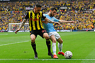 Bernardo Silva (20) of Manchester City holds off Jose Holebas (25) of Watford during the The FA Cup Final match between Manchester City and Watford at Wembley Stadium, London, England on 18 May 2019.