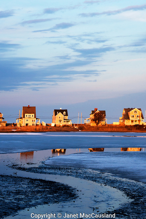 A necklace of beach houses reflect in the salt creek of Scituate, Massachusetts, south of Boston, Massachusetts. this vertical format is also available as a horizontal image, taken separately.