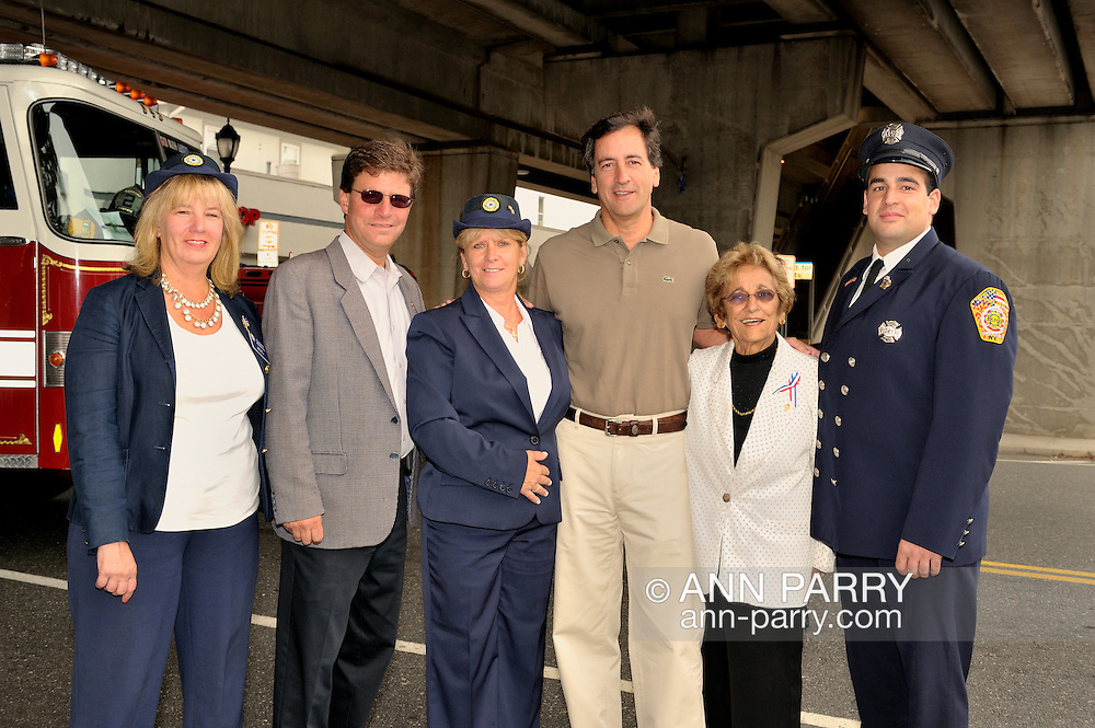 At Merrick 9/11 Tenth Anniversary ceremony are (left to right) North and Central Merrick Civic Association President & candidate for Hempstead Town Council Claudia Borecky, Legislator David Denenberg, Debra Bernhardt, Senator Fuschillo, Hempstead Town Councilwoman Angie Cullen, and Merrick Firefighter, at Long Island, New York, USA, on September 11, 2011.