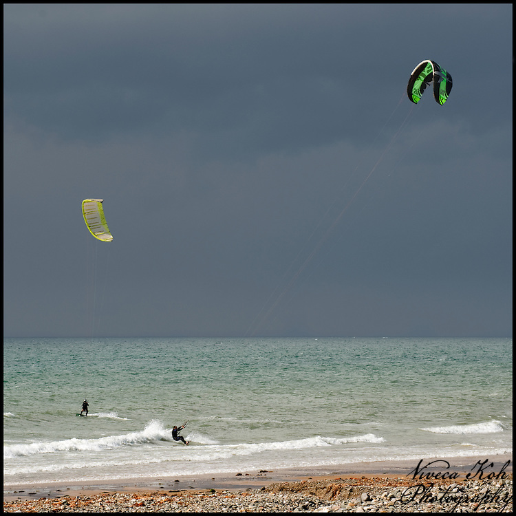 Two kite surfers on the sea