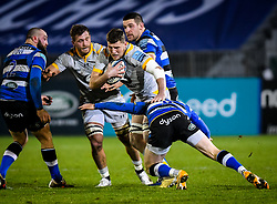 Ben Spencer of Bath Rugby attempts a tackle on Tom Willis of Wasps - Mandatory by-line: Andy Watts/JMP - 08/01/2021 - RUGBY - Recreation Ground - Bath, England - Bath Rugby v Wasps - Gallagher Premiership Rugby