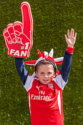 © Licensed to London News Pictures. 30/05/2015. London, UK. A young Arsenal supporter makes his intentions known, as fans gather at Wembley Stadium for the FA Cup Final 2015, between Arsenal and Aston Villa. Photo credit : Stephen Chung/LNP