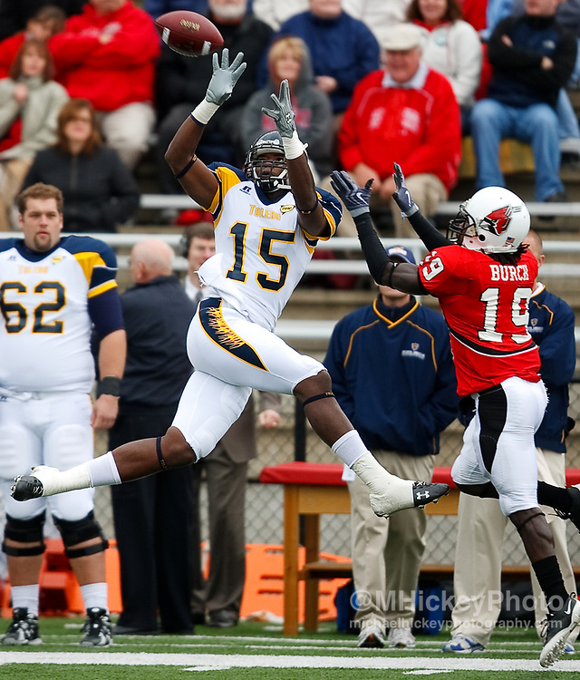 Toledo University wide receiver Robin Bailey goes up for a pass reception during NCAA football action against Ball State.<br /> Photo by Michael Hickey, sports photography