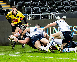 Dan Lydiate of Ospreys is tackled high by Tomos Williams of Cardiff Blues resulting in a penalty try<br /> <br /> Photographer Simon King/Replay Images<br /> <br /> Guinness PRO14 Round 8 - Ospreys v Cardiff Blues - Saturday 21st December 2019 - Liberty Stadium - Swansea<br /> <br /> World Copyright © Replay Images . All rights reserved. info@replayimages.co.uk - http://replayimages.co.uk