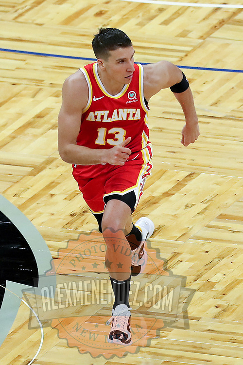 ORLANDO, FL - MARCH 03: Bogdan Bogdanovic #13 of the Atlanta Hawks runs the court against the Orlando Magic at Amway Center on March 3, 2021 in Orlando, Florida. NOTE TO USER: User expressly acknowledges and agrees that, by downloading and or using this photograph, User is consenting to the terms and conditions of the Getty Images License Agreement. (Photo by Alex Menendez/Getty Images)*** Local Caption *** Bogdan Bogdanovic
