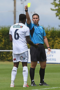 Match referee Calvin Berg issues a yellow card to Auckland City FC's Brian Kaltack in the Handa Premiership football match, Hawke's Bay United v Auckland City FC, Bluewater Stadium, Napier, Sunday, January 31, 2021. Copyright photo: Kerry Marshall / www.photosport.nz