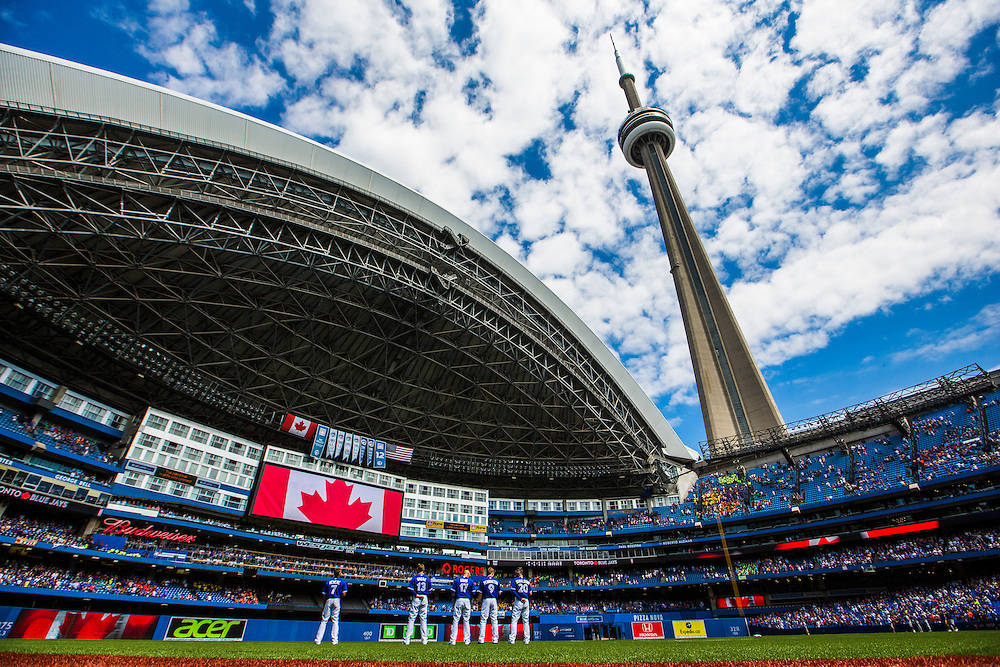 Toronto, Ontario - August 13, 2015 -- TORONTO BLUE JAYS --  Toronto Blue Jays players line up for the national anthem before they play the Oakland Athletics during their MLB baseball game in Toronto, Thursday August 13, 2015.   (Mark Blinch for the Globe and Mail)