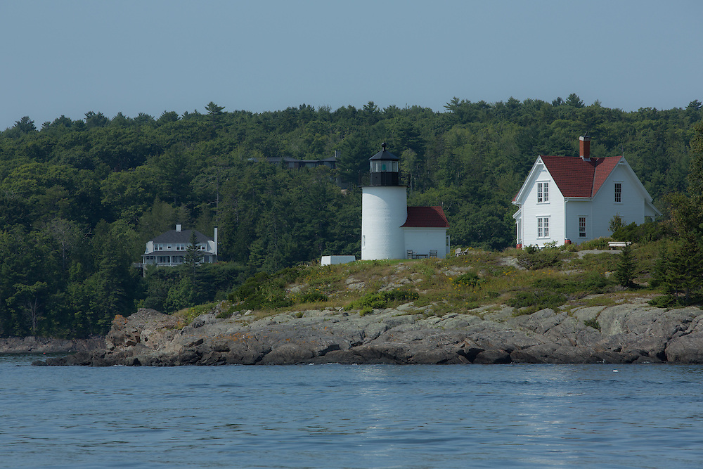 Camden, ME - 11 August 2014. Curtis Island light marking the entrance to Camden. A lighthouse was first built there in 1836, and the current tower, completed in 1896, replaced the original. Since it was just outside of Camden, it was a plum assignment for lighthouse keepers.The lighthouse is now owned and maintained by the town of Camden.