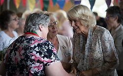 The Duchess of Cornwall is introduced to people at Newquay Fire Station, Cornwall, as she meets residents from Tregunnel Hill, a mixed-use neighbourhood built on Duchy of Cornwall land in Newquay comprising open-market and affordable homes.