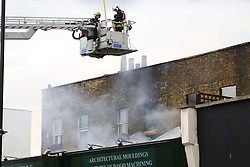 © Licensed to London News Pictures. 15/06/2015. London, UK. Firefighters trying to stop a blaze on Yorkton Street, Hackney on Monday, June 15, 2015. Photo credit: Tolga Akmen/LNP