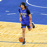 ORLANDO, FL - APRIL 18: Cole Anthony #50 of the Orlando Magic dribbles the ball against the Houston Rockets at Amway Center on April 18, 2021 in Orlando, Florida. NOTE TO USER: User expressly acknowledges and agrees that, by downloading and or using this photograph, User is consenting to the terms and conditions of the Getty Images License Agreement. (Photo by Alex Menendez/Getty Images)*** Local Caption ***  Cole Anthony