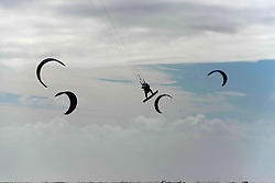 © Licensed to London News Pictures. 22/08/2020. Pembrey sands, Carmarthenshire, Wales, UK. Kite surfer enjoy the strong winds at Pembrey Sands in Carmarthenshire, Walse, UK.. Photo credit: Graham M. Lawrence/LNP