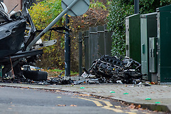 © Licensed to London News Pictures. 07/12/2019. London, UK. A car engine block sits on the pavemrnt after a fatal road traffic collision, a black BMW hit a lamp post in the crash, the impact ripped the engine block from the car and it caught fire.<br /> Police were called at 09:08 GMT on Saturday 7th December 2019 to reports of a car in collision with a lamp post on Dollis Hill Lane at the junction with Brook Road, NW2. Metropolitan Police Officers, the London Ambulance Service and London Fire Brigade attended. Two people were recovered from the vehicle. The male driver was pronounced dead at the scene at 09:21 GMT. The passenger has been taken to a central London hospital. Photo credit: Peter Manning/LNP
