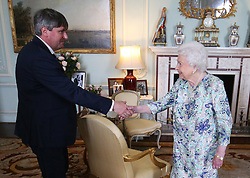 Queen Elizabeth II receives Simon Armitage to present him with The Queen's Gold Medal for Poetry upon his appointment as Poet Laureate during an audience at Buckingham Palace, London.