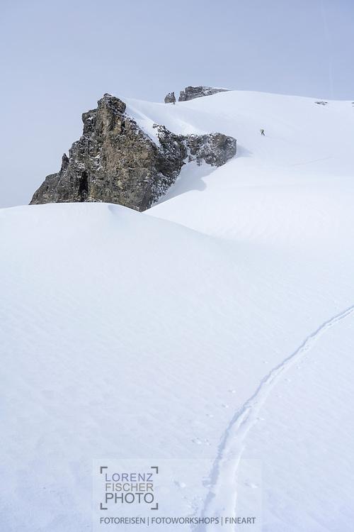 Wind gusts close to the peak of mount Zwächten on a ski tour from the Meiental on mount Zwächten with a descent to the Erstfeld valley, Uri, Switzerland<br /> <br /> Skitour vom Meiental auf den Zwächten mit Abfahrt ins Erstfelder Tal, Uri, Schweiz
