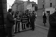 Cork Shoe Workers Protest.     K15..1976..24.03.1976..03.24.1976..24th March 1976..In protest at the winding up of the Cork shoe industry, 10 workers  from the Cork Shoe Co marched from Cork to Dublin to meet with TDs at Leinster House. The protest was to highlight the closure of The Cork shoe Co resulting in the unemployment of all the staff..Image of the Cork Shoe Co workers as they picket the Dail.