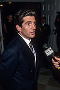 John Kennedy, Jr arrives for the State Dinner for British Prime Minister Tony Blair at the White House February 5, 1998 in Washington, DC.