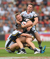 Hull FC's Chris Green is tackled by Leeds Rhinos' Brad Singleton and Matt Parcell during the Challenge Cup Semi Final match at The Keepmoat Stadium, Doncaster.