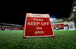 A general view of a Please Keep Off The Pitch sign on display before the match