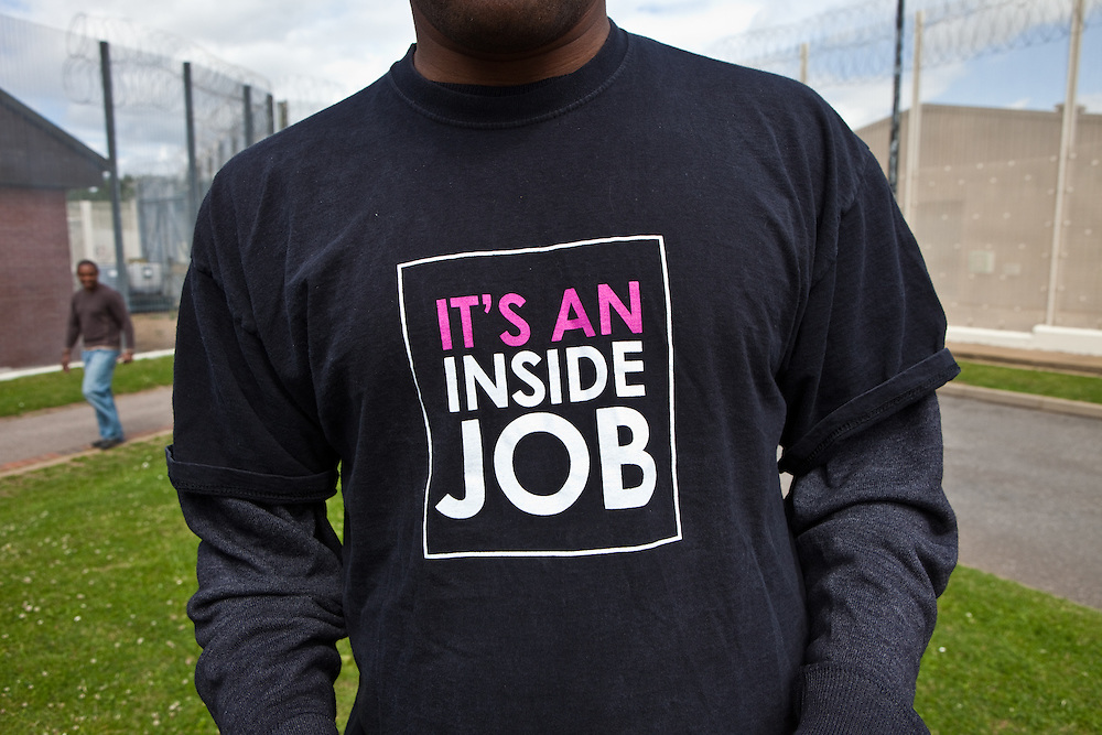 A prisoner in the grounds of the prison showing off his new t-shirt. HMP The Mount, Bovingdon, Hertfordshire