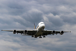 Against a backdrop of rain clouds, A Singapore Airlines' Airbus A380 lands at London Heathrow on Runway 27R (LHR / EGLL).