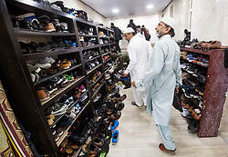 Worshippers remove their shoes as they arrive ahead of the Eid prayer, which marks the end of Ramadan and the start of Eid, at Leeds Grand Mosque in Yorkshire.
