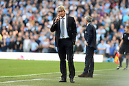 Manchester city manager Manuel Pellegrini looks on during the match. Barclays premier league match, Manchester city v Chelsea at the Etihad stadium in Manchester,Lancs on Sunday 21st Sept 2014<br /> pic by Andrew Orchard, Andrew Orchard sports photography.