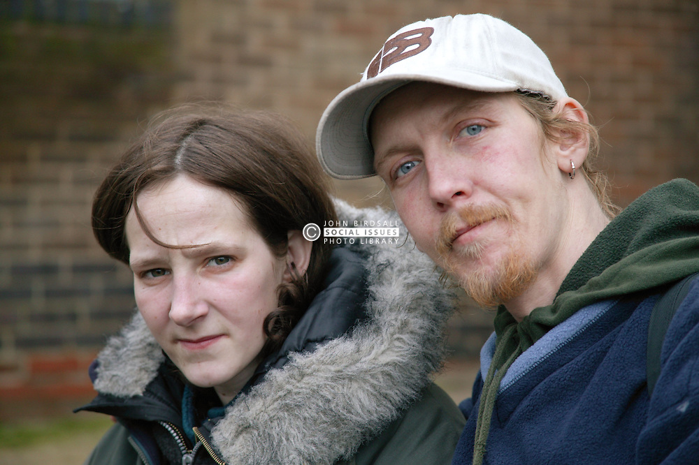 Homeless couple living in the city streets,