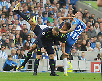 Football - 2017 / 2018 Premier League - Brighton & Hove Albion vs. Everton<br /> <br /> Wayne Rooney and Dominic Calvert - Lewin of Everton tussle with Shane Duffy at The Amex.<br /> <br /> COLORSPORT/ANDREW COWIE