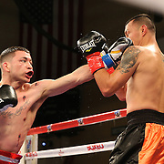 KISSIMMEE, FL - MARCH 06:  Charles Natal (L) connects with a jab to the face of Juan Aguirre during the Telemundo Boxeo boxing match at the Kissimmee Civic Center on March 6, 2015 in Kissimmee, Florida. (Photo by Alex Menendez/Getty Images) *** Local Caption ***  Charles Natal; Juan Aguirre