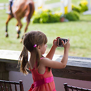 """Child shutter-bug photographer at a horse show.<br /> <br /> For all details about sizes, paper and pricing starting at $85, click """"Add to Cart"""" below."""