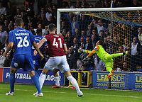 Football - 2018 / 2019 EFL Carabao Cup (League) Cup - AFC Wimbledon vs. West Ham United<br /> <br /> Joe Pigott of Wimbledon scores his goal past the diving Adrian, at Cherry Red Records Stadium (Kingsmeadow).<br /> <br /> COLORSPORT/ANDREW COWIE