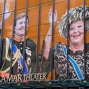 NLD/Amsterdam/20130423 - Buitenzijde DeLaMar theater in Amsterdam versierd met de beeltenis van Koning Willem - Alexander en prinses Beatrix