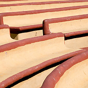 Empty adobe seats at a municipal stage in downtown Zihuatanejo, Mexico