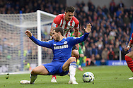 Eden Hazard of Chelsea loses his footing as he is pressured by Jose Fonte, the Southampton captain.. Barclays Premier league match, Chelsea v Southampton at Stamford Bridge in London on Sunday 15th March 2015.<br /> pic by John Patrick Fletcher, Andrew Orchard sports photography.