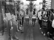 April 26, 2015, Tokyo: Street views of Shinjuku in and around the 4-Chome and 3-Chome areas on a crowded Sunday Spring afternoon. The mannequins in the window are part of H&M store on Meiji Dori. This was during a photo oputing with photographer Misha Erwitt of New York. Taken with Ricoh GR2 camera. Photo by Torin Boyd.