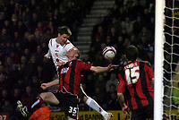 Photo: Matt Bright/Sportsbeat Images.<br /> AFC Bournemouth v Swindon Town. Coca Cola League 1. 29/12/2007.<br /> Barry Corr of Swindon heads past Alex Pearce of Bournemouth to score the equaliser