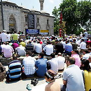 Muslim prayer outside a mosque at Istanbul