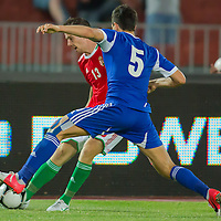 Hungary's Tamas Koltai (back) and Israel's Rami Gershon (front) fight for the ball during a friendly football match Hungary playing against Israel in Budapest, Hungary on August 15, 2012. ATTILA VOLGYI