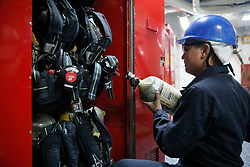 170410-N-KK167-338<br />NEWPORT NEWS, Va. (April 10, 2017) Damage Controlman Fireman Calvin Tran from Anaheim, Calif., stows a self-contained breathing apparatus after inspecting it on board the Nimitz class aircraft carrier USS Abraham Lincoln (CVN 72). Abraham Lincoln is in the final stages of a four-year Refueling and Complex Overhaul and will be delivered back to the fleet in early 2017. (U.S. Navy photo by Mass Communication Specialist Seaman Eddie Ortiz/Released)
