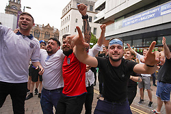 © Licensed to London News Pictures. 29/06/2021. Manchester, UK. England fans celebrate as they watch the England v Germany football match. . Photo credit: Ioannis Alexopoulos/LNP