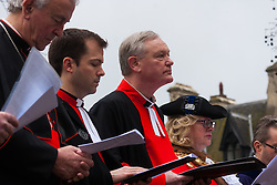Hundreds of Christians in London take part in the interdenominational Methodist, Anglican and Catholic March of Witness in Westminster. PICTURED: Members of the clergy sing hymns as they prepare to follow the cross to Westminster Cathedral.