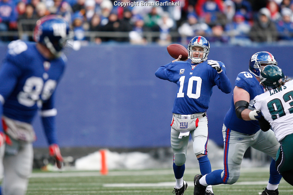 11 Jan 2009: New York Giants quarterback Eli Manning #10 throws a pass during the game against the Philadelphia Eagles on January 11th, 2009.  The  Eagles won 23-11 at Giants Stadium in East Rutherford, New Jersey.
