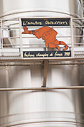 L'autre Obsession, Tauchans Champion de France 1998 - the other obsession (Rugby), Tauchan French cup winner in 1998 Mont Tauch Cave Cooperative co-operative In Tuchan. Fitou. Languedoc. Sign on tank. Stainless steel fermentation and storage tanks. France. Europe.
