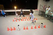 Kinderen doen mee aan een sprint. In het Civic Center worden de fietsen getoond aan de kinderen van Battle Mountain. In de buurt van Battle Mountain, Nevada, strijden van 10 tot en met 15 september 2012 verschillende teams om het wereldrecord fietsen tijdens de World Human Powered Speed Challenge. Het huidige record is 133 km/h.<br /> <br /> Children are sprinting at the 'show and shine' in the Civic Center where competitors of the WHPSC are showing their bikes. Near Battle Mountain, Nevada, several teams are trying to set a new world record cycling at the World Human Powered Vehicle Speed Challenge from Sept. 10th till Sept. 15th. The current record is 133 km/h.