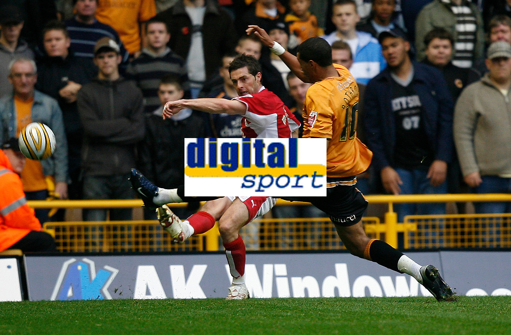 Photo: Steve Bond/Sportsbeat Images.<br /> Wolverhampton Wanderers v Bristol City. Coca Cola Championship. 03/11/2007. ay Bothroyd lunges in as a Bristol defender clears